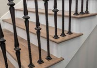 close-up hardwood stair treads wrought iron ballusters
