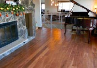 piano and fireplace Hickory floor