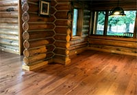 log cabin with character hickory flooring
