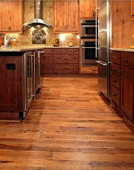 Prefinished hardwood flooring vs unfinished prefinished for Wood floor quality grades