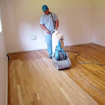 Hardwood floor drum sander vs belt sander differences for Sanding hardwood floors