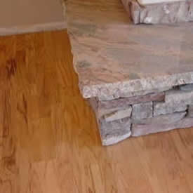 Hardwood under stone fireplace