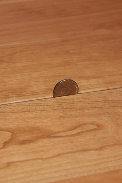 Hardwood floor gaps cracks why how to fix for Wood floor expansion gap