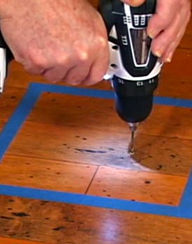 Drill hole in floor for glue
