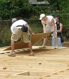 Installing plywood subfloor over floor joists