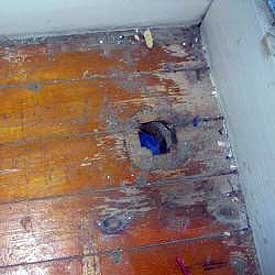 Hole in wood floor from radiator heating