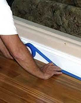 Apply tape to hardwood floor