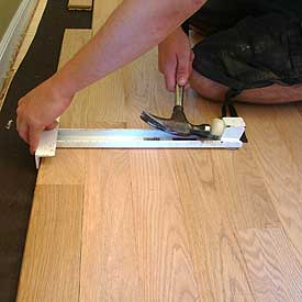 how to fix warped laminate flooring